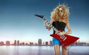 Chica y guitarra eléctrica