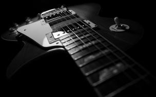 Guitarra y fondo negro