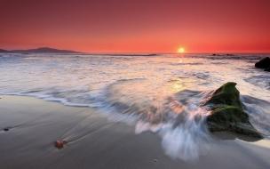 Amanecer pintado en playa