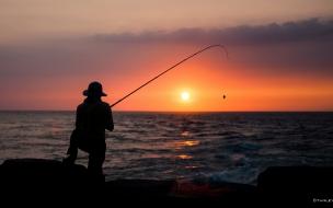 Pesca y puesta de sol