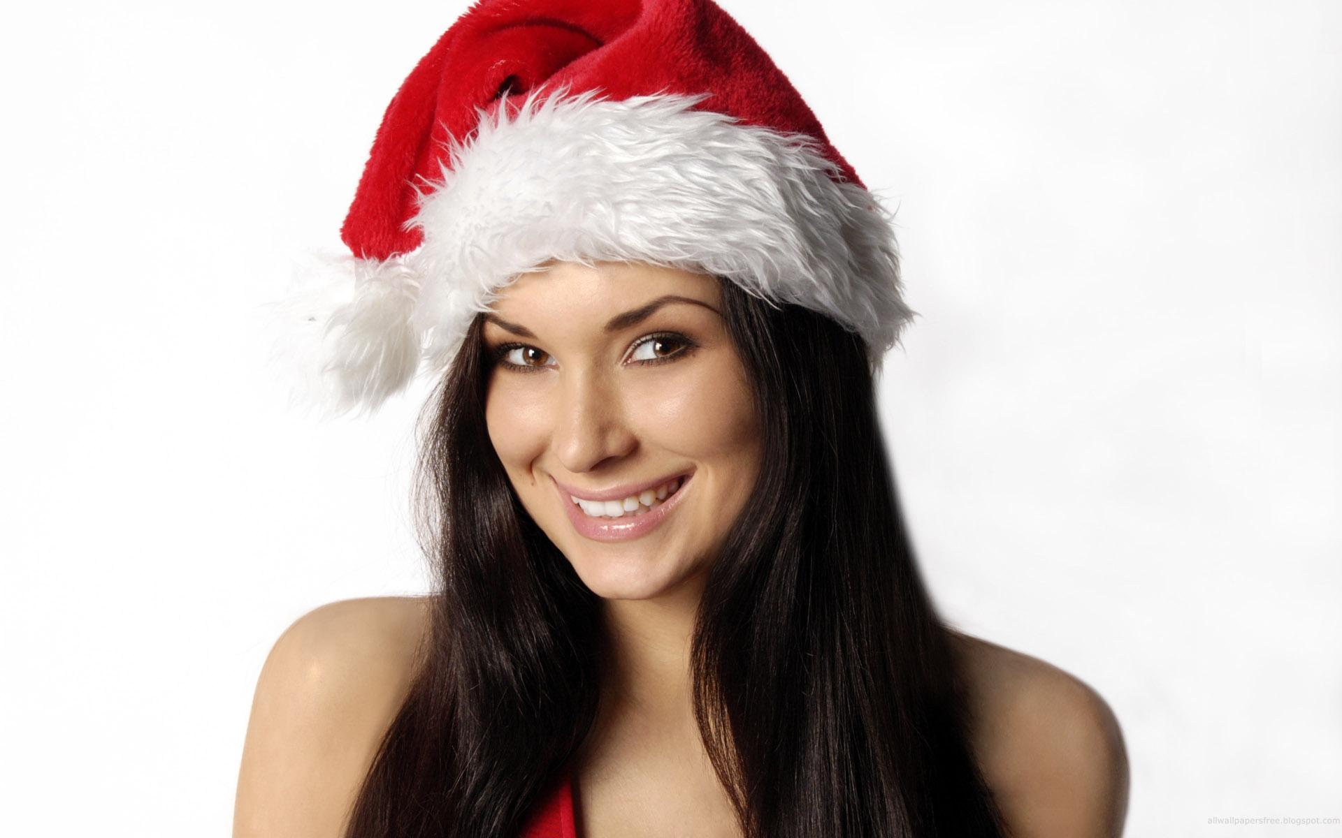 Hermosa mujer con gorra de navidad - 1920x1200