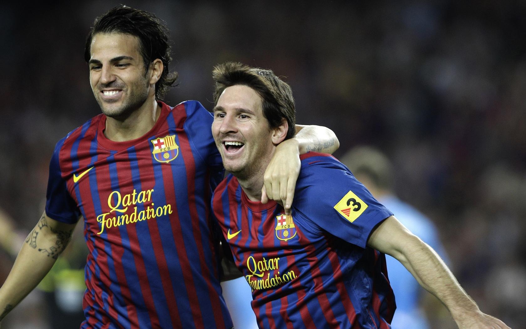 Cesc Fabregas y Lionel Messi - 1680x1050