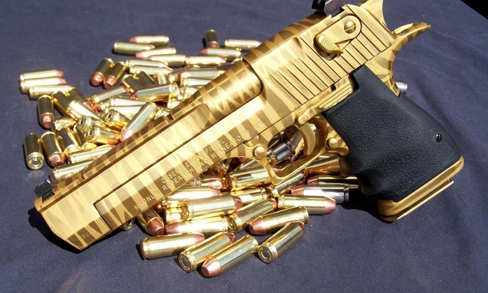 Pistola de Oro - 1000x600