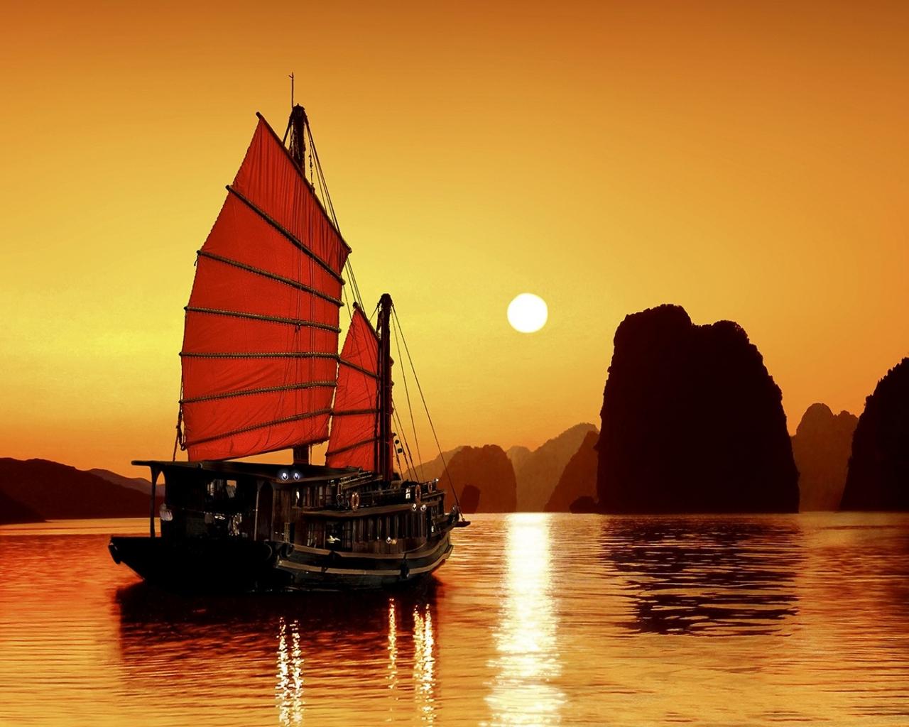 Un atardecer y un barco - 1280x1024