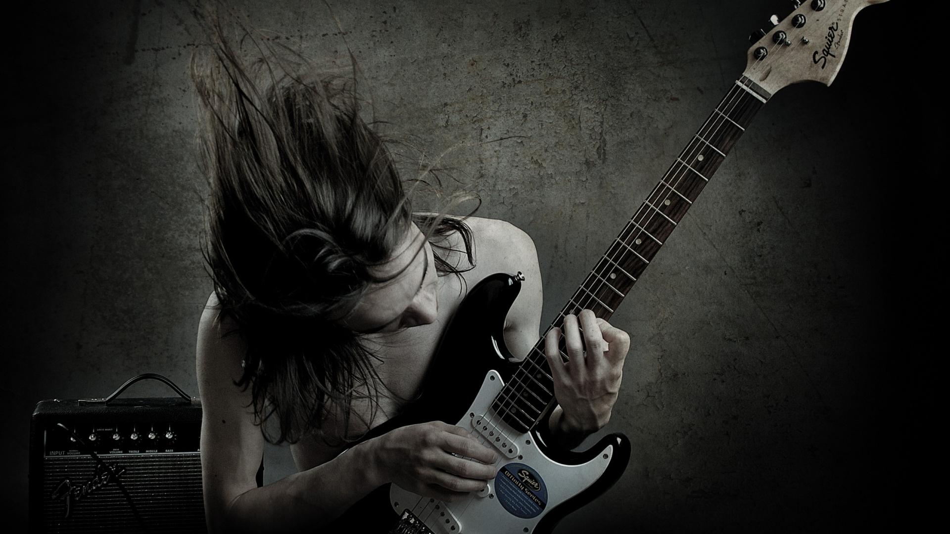 Un guitarrista con una Squier - 1920x1080