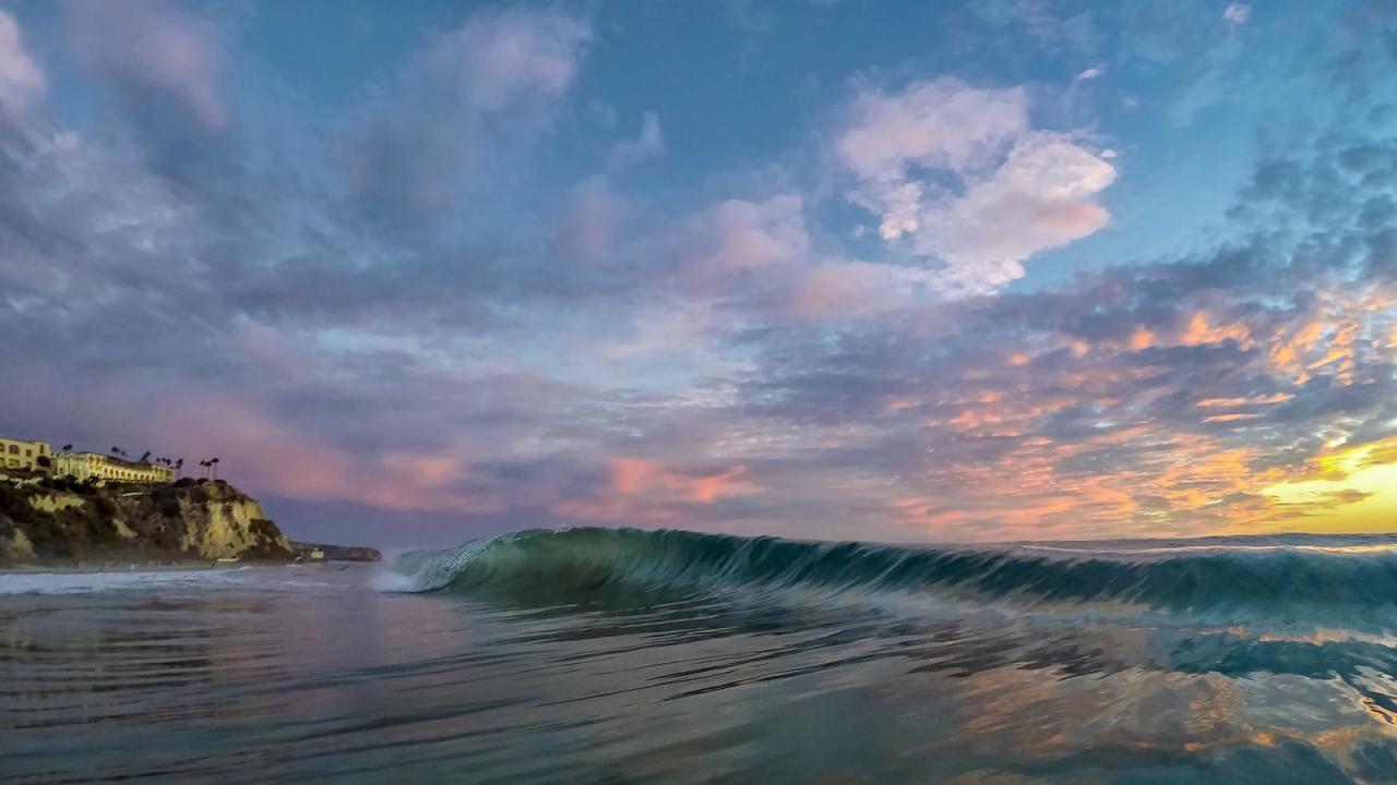 Las olas al atardecer - 1280x720