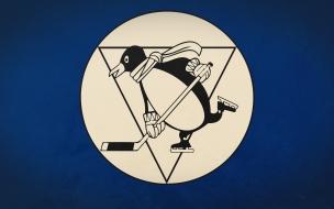 Pinguino jugando Hockey