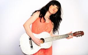 Cantantes con guitarras