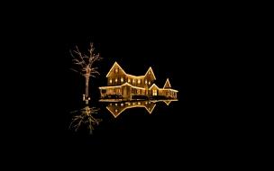 Fondo negro con casa con luces de navidad