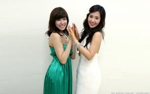 Kwon Yuri y Tiffany Hwang
