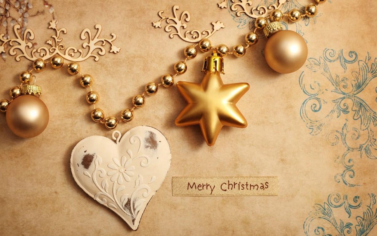Fondo dorado con adornos de navidad - 1229x768