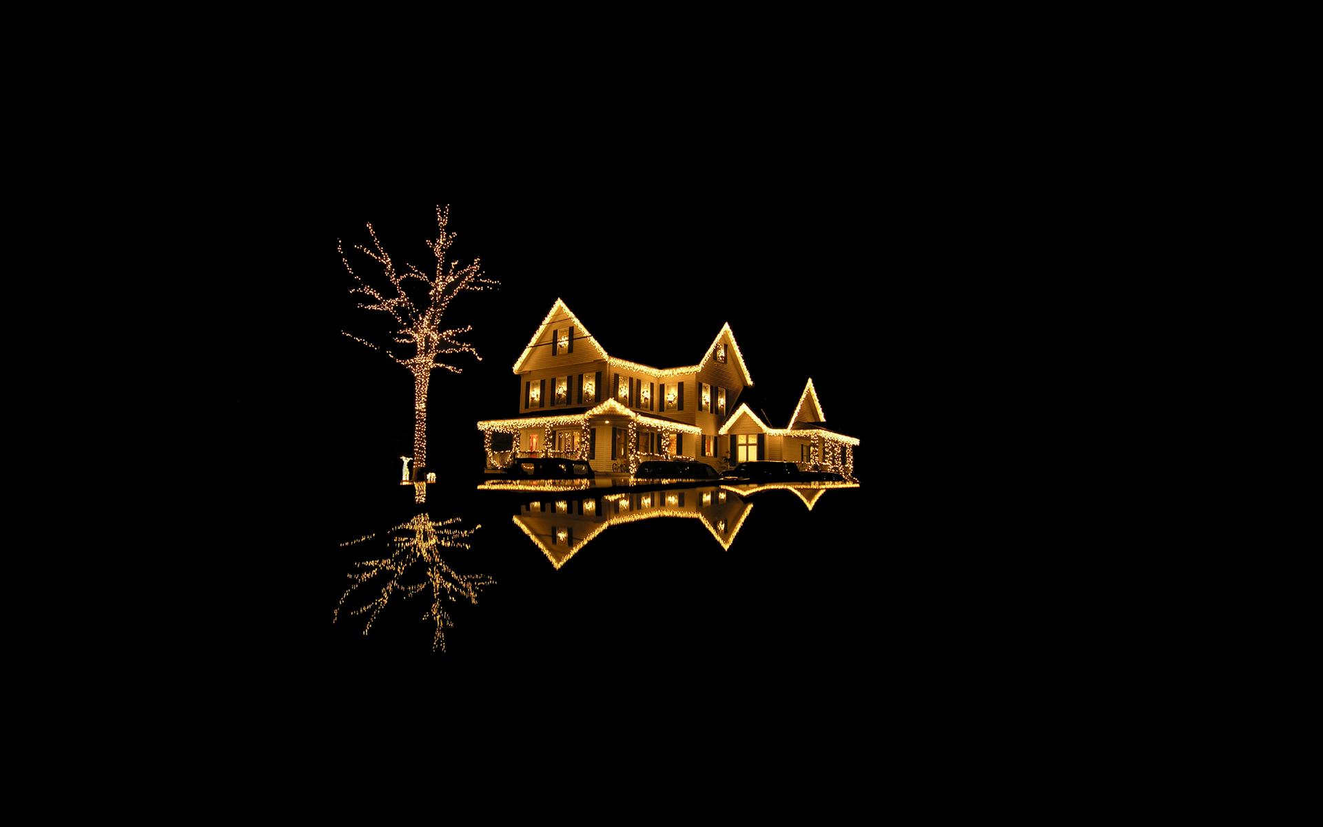 Fondo negro con casa con luces de navidad - 1920x1200
