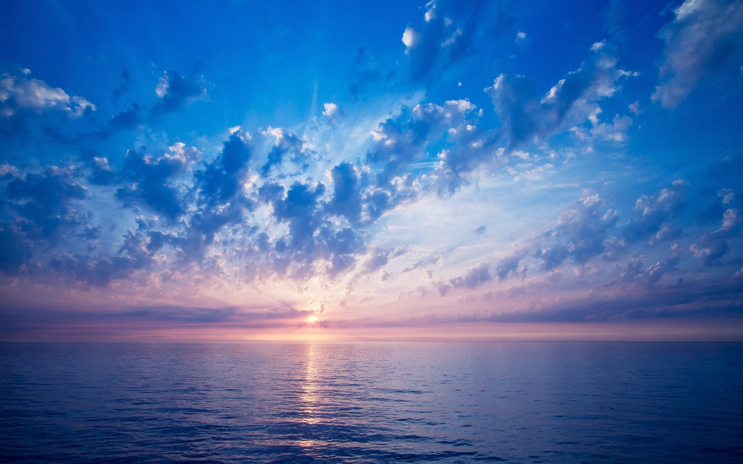 Puesta de sol en mar abierto - 2560x1600