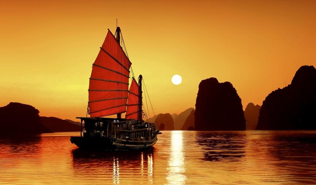 Un atardecer y un barco - 1024x600