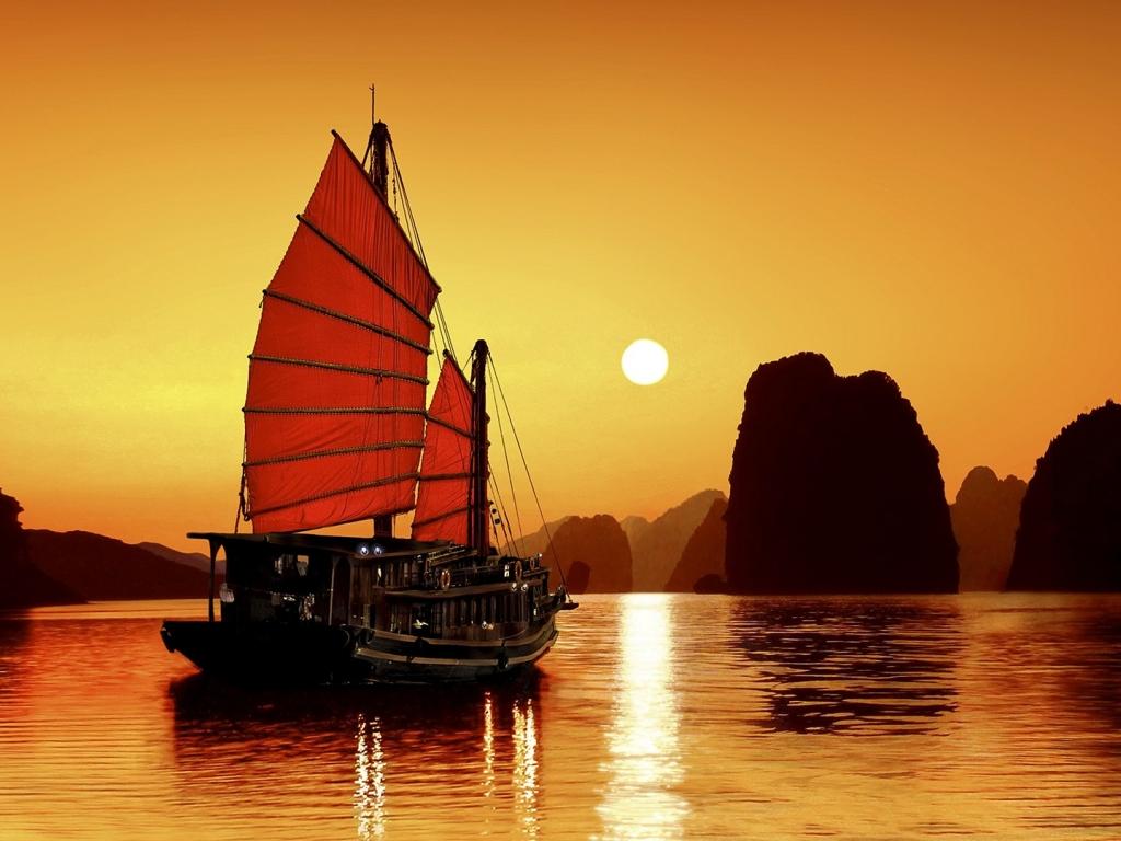 Un atardecer y un barco - 1024x768