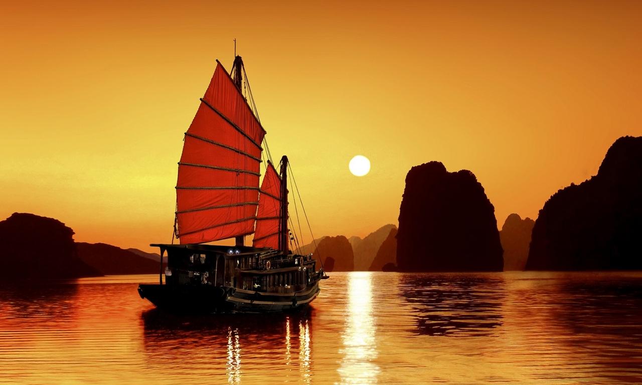 Un atardecer y un barco - 1280x768