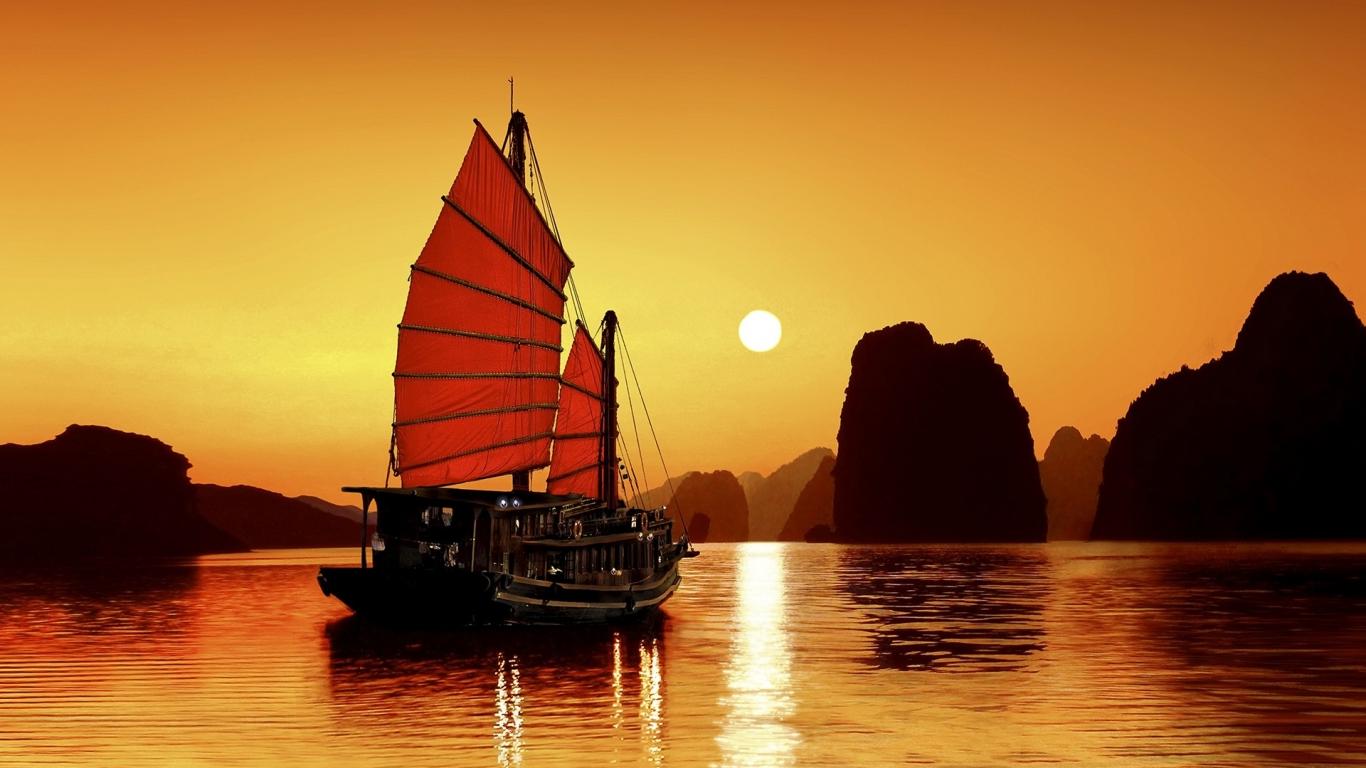 Un atardecer y un barco - 1366x768