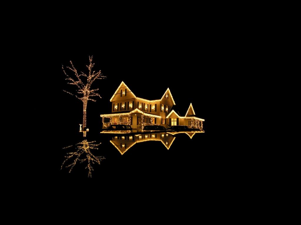Fondo negro con casa con luces de navidad - 1024x768