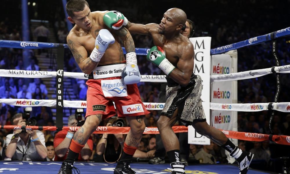 Floyd Mayweather peleando - 1000x600