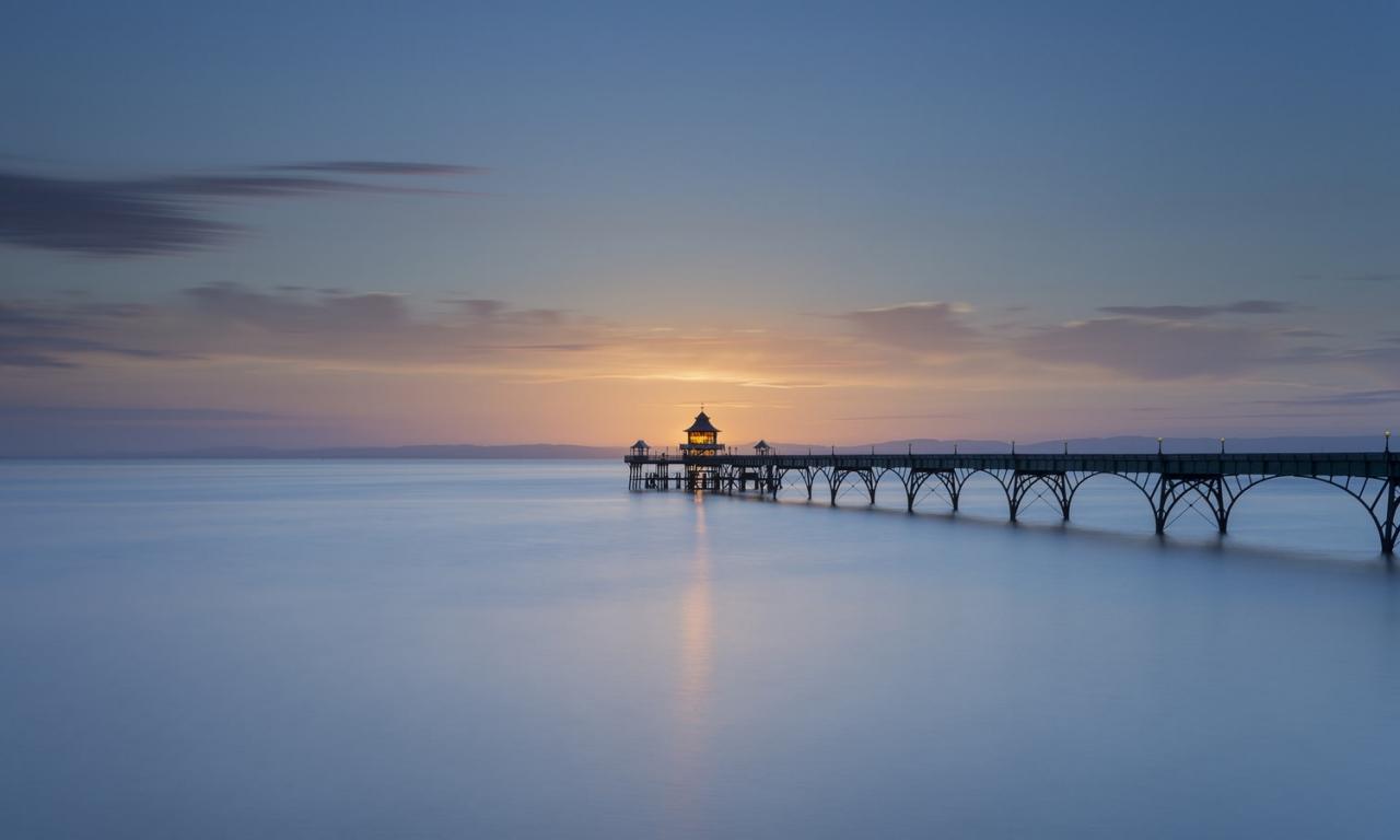 Puesta de sol con un puente - 1280x768