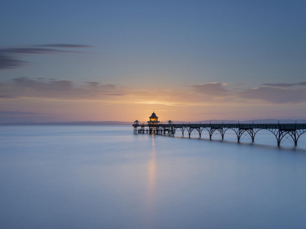 Puesta de sol con un puente - 1280x960