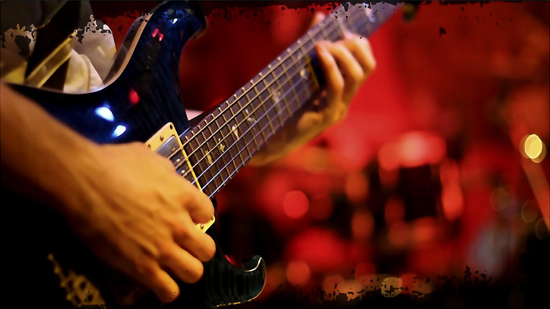 Una guitarra en un musico - 1920x1080